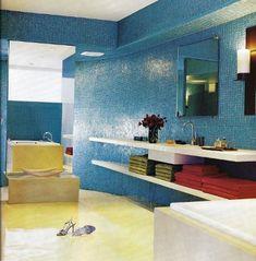 Bold Bathroom Color - ocean blue glass mosaic tile bathroom with cream epoxy floor