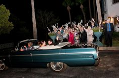 The guests waving goodbye to the bride and groom in their get-away car is a must-get photo