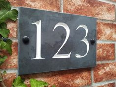 Bespoke engraved Slate Signs ideal for House Names, House Numbers and Address Plates. Personalised to your requirements with a choice of fonts and paint inlay colours. Our ever popular engraved slate house signs have deep V-grooved numbers and . House Plaques, House Number Plaque, House Front, My House, Front Porch, Slate House Numbers, Slate Signs, House Names, Sign Maker