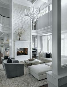 May 2019 - White living room decor, contemporary modern swivel chairs and white sectional sofa Luxury Homes Interior, Modern Interior Design, Contemporary Interior, Contemporary Apartment, Scandinavian Interior, Living Room With Fireplace, Living Room Decor, Decor Room, Interior Design Living Room
