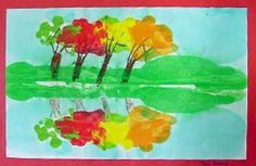 """Fold the paper the long way (hotdog way). draw a series of trees using the """"Y"""" method.  Try to work them across the paper until it is full of trees.   Once you've drawn the trees, fold the paper and then blob paint in dots, fold t give leaves"""