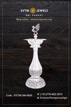 An antique lamp is crafted in a silver. The peacock sculpture and floral engravings highlight the lamp. Shipping across India and USA. Antique Jewellery Designs, Gold Jewellery Design, Silver Jewellery, Indian Jewelry, Antique Jewelry, Antique Lamps, Antique Silver, Silver Pooja Items, Kids Blouse Designs