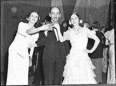 Nina Raievska (left) and Valentina Blinova with Arnold Haskell; Russian Ballet at JC Williamson New Year Party, Sydney, 31 December 1936 / Sam Hood.    Find more detailed information about this photograph: http://acms.sl.nsw.gov.au/item/itemDetailPaged.aspx?itemID=15668      From the collection of the State Library of New South Wales www.sl.nsw.gov.au