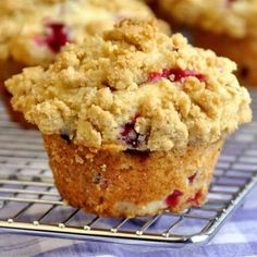 Cranberry Crunch Muffins - a moist delicious muffin with pops of tart cranberry inside and a buttery oatmeal crumble on top. Brunch just got a lot tastier!
