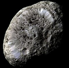 Saturn's Hyperion: A Moon with Odd Craters actual photo.