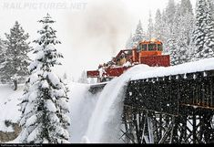 SPMW 4030 Union Pacific Jordan Spreader at Donner Pass, California -- Clearing snow methods have come and gone, and those that have worked have been improved and modernized over the years by Central Pacific successors Southern Pacific and later Union Pacific.Originally built for the Southern Pacific, Union Pacific Jordan Spreader SPMW4030 is propelled by a pair of former SP snow service GP38-2s, clearing fresh Sierra Cement off the #1 track and down into the ravine below ...--- USA