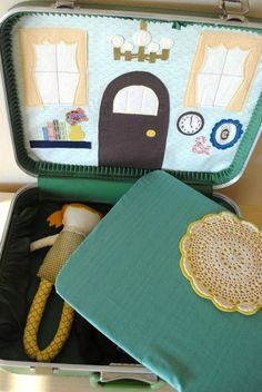 Adorable dollhouse in an old suitcase with 3 interchangeable room backdrops