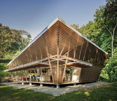 Slanted wooden louvres offer natural light and cross-ventilation in this prefabricated house in Costa Rica, which architecture studio A-01 created as a prototype for a series of future zero-carbon homes. Prefabricated Houses, Prefab Homes, Building Design, Building A House, Green Building, Houses In Costa Rica, Tropical Architecture, Bamboo Architecture, Origami Architecture