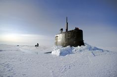 USS Connecticut surfaces through the ice during exercise. by Official U.S. Navy Imagery