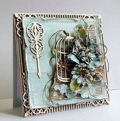 I think the Polish / Eastern Europeans are the Goddesses of craft making at the moment ! Shabby chic hand made greetings card with bird cage elements and antique prima flowers.