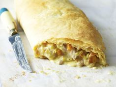 Flaky, golden filo pastry wrapped around a creamy chicken and leek filling makes for a delicious savoury strudel.