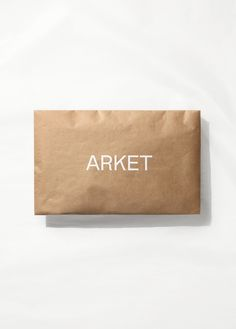 """Earlier this year it was announced that a new high-street brand was launching, Arket, a name deriving from the Swedish translation, meaning """"sheet of paper"""". On the surface, the branding is simplistically elegant and evocative of its values and products. Perfume Packaging, Bag Packaging, Paper Packaging, Print Packaging, Clothing Packaging, Fashion Packaging, Corporate Design, Branding Design, Logo Design"""