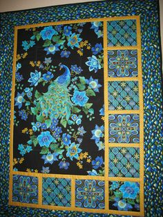 Peacock Quilted Wall Art in Timeless Treasure Plume Fabric. via Etsy. By Picket Fence Fabric, measures 36.5 x 48.5