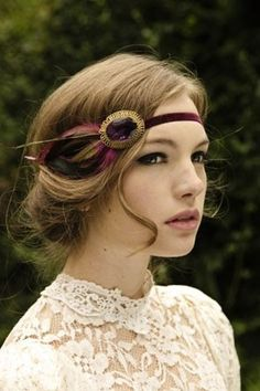 From boho to Art Deco, this velvet and feather headband is pretty amazing, especially with shorter hairstyles. | See more glam headbands here: http://www.mywedding.com/articles/glam-headbands-for-brides-and-bridesmaids/