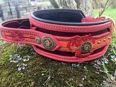 This is an originally designed, hand tooled, leather dog collar featuring a steampunk and dragon design. It is 3 inches width at its widest point tapering to 1.5 hardware, with a 1.25 wide handle. (If youd like this collar in a smaller width please message and I will work with you on a scaled down design). Perfect for Bite work, Agitation, and Service Dog Disciplines. Feel free to request custom colors! The handle will be tooled with your dogs name or your desired text on the handle, plea...