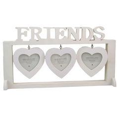 Very pretty photo frame stand with individual hanging heart photo frames. Perfect for a wedding gift. Measures in total 33 x 19 x 6cm.