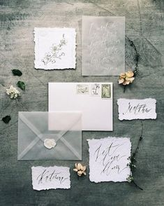 grey calligraphy and vellum wedding invitation