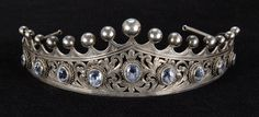 ITALIAN FINE SILVER AND AQUAMARINE TIARA BY PERUZZI	  With nine aquamarines in various sizes set in a filagree tiara (Eldreds)