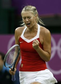 Russia's Maria Sharapova celebrates after winning a point in her women's singles tennis match against Israel's Shahar Peer at the All England Lawn Tennis Club during the London 2012 Olympics Games July 29, 2012.