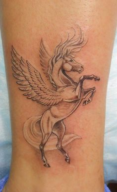 Super_white_jumping_pegasus_tattoo_on_ankle.jpg (616×1006)