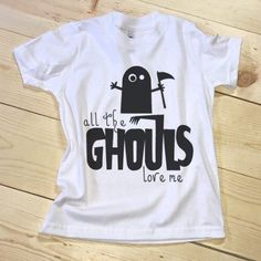 Calling all the ladies men... the Ghouls love you! Express your style this Halloween with our fun seasonal tees. Our kids + youth sizes range from 3-6 months through size 12, so there's something for everyone!  Our shirts are soft, lightweight, and made in the USA. Our designs are made from commercial-grade, light, flexible heat transfer vinyl. We use a commercial press to bring you quality, long-lasting products. The end result is extremely durable, wash after wash.  We love color as much…