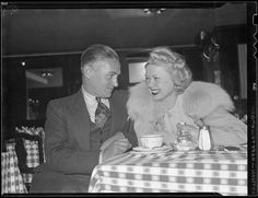 Dick Merrill - trans-Atlantic flier and Toby Wing - actress. He plans flight. by Boston Public Library, via Flickr