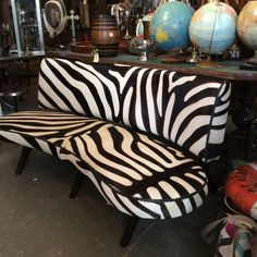 An attention grabber for sure! The zebra stenciled cowhide print sofa adds the exotic to a living room, family room, game room or dining room banquette.  Golden Oldies 310 W Broad Ave.