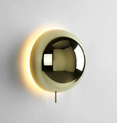 MILAN DESIGN WEEK 2015: D' Review Part Two  |  Philippe Malouin's Eclipse Sconce for Roll & Hill creates a corona of light that becomes larger and brighter as the sconce's dome extends from the wall.