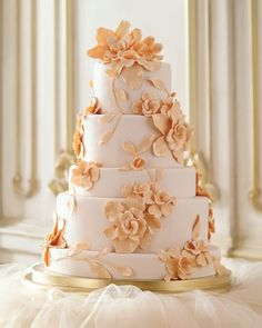 "Cake by Wendy Kromer | This enchanting cake takes inspiration from one of Alberta Ferretti's ornately designed dresses. Contributing editor Wendy Kromer, owner of Wendy Kromer Specialty Confections, crafted the blooms from gum paste and attached them to tiers covered in peach-tinted fondant with royal icing. To carry the peach theme to the filling, stick with jam, not fresh fruit. ""Fondant cakes are made the day before an event, and anything fresh will start to ooze into the layers in a few…"