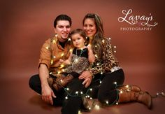 Family Christmas picture with lights @Brittany Horton Moody I said I wanted to do these last year, this year I mean it lol