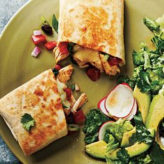Chicken and Black Bean-Stuffed Burritos by Cooking Light. These skillet-grilled burritos come together in a flash thanks to store-bought rotisserie chicken. Keep this meal light by serving with a fresh green salad.