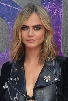 Gorgeous Cara Delevingne with soft wavy hairstyle and metallic smokey eyes at…