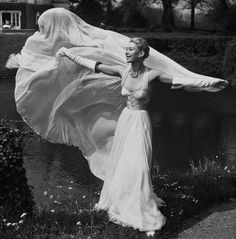 Model wearing a gown by Jean Desses, 1953. #EasyNip