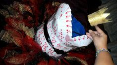 Queen of hearts DIY costume for alice in wonderland themed trunk. She made a top out of cards hot glued together, a crown by painting a solo cup, and a tutu.