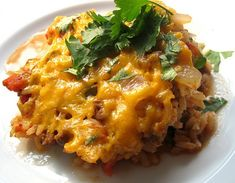 Spanish Rice Bake - This dish is true comfort food. Easy to prepare and satisfying to serve. You have flexibility with how much beef you  add, only use half a pound and you won't miss the extra meat.
