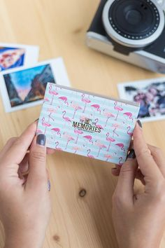 Photo album for 20 instax mini snaps. This handy album is the perfect way to keep your most recent travel photos safe and sound.  Key features: - Holds 20 Instax Mini size photos - Perfect for traveling - Handy size - Flamingo print design