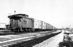 Two Morrell reefers are tucked in front of the caboose on this hotshot eastbound Baltimore & Ohio freight leaving Willard, Ohio, in 1965.