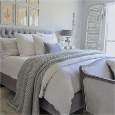 frames above bed / bedding layers / antique shutter