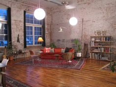 Large space broken up with old vintage rugs, the natural look brick walls are great.
