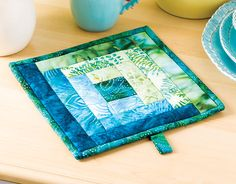 Courthouse Steps Pot Holder featured in Learn to Quilt As You Go with Nancy McNally. Watch a free preview here: https://www.anniescatalog.com/onlineclasses/detail.html?code=QFV04