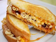 The Mac 'N Cheese Grilled Cheese Creamy macaroni and cheese, savory bacon, and gooey cheddar is an amazing combo, even when not in a sandwich, and the generously buttered and grilled white bread adds a satisfying crunch Grilled Mac And Cheese, Creamy Macaroni And Cheese, Grilled Cheese Recipes, Mac Cheese, Vegemite Recipes, Lunch On A Budget, Cheese Dishes, Tasty Dishes, Serious Eats