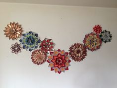 These are handmade flowers that my aunt Anita made out of paper. They are hanging in her home!!  Beautiful.