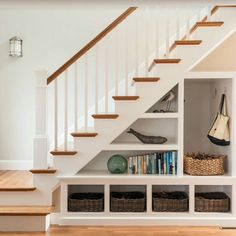 """Lovely way of adding some storage under the stairs"""