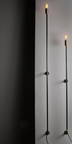 a couple of these would look cool in our living room. Skinny Sconce John Beck Remodelista