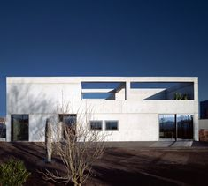 Raw concrete house designed by Denzer & Poensgen using the golden ratio as guide.  Located in Trier, Germany.