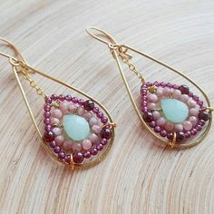 Freesia gemstone beaded hoop earrings charm with their unique design and the lovely soft colors of the gemstones.