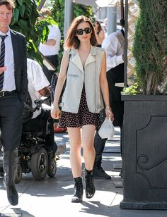 Stylish lady: Lily Collins, 27, looked great in a flirty mini worn with chunky boots and a waistcoat as she headed out in LA on Thursday