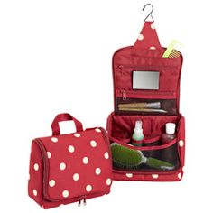 GREAT FOR TRAVELING!  I want.  Super cute.  The Container Store > Ruby Dots Hanging Toiletry Organizer by reisenthel®