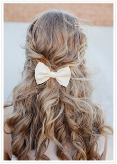 messy curls and white fabric bow