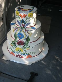 Here is your authentic wedding cake design, inspired by folkloristic embroidery on an antique Spanish wedding dress. This cake is from Cake Coquette - look it up at Weddingwoof.com
